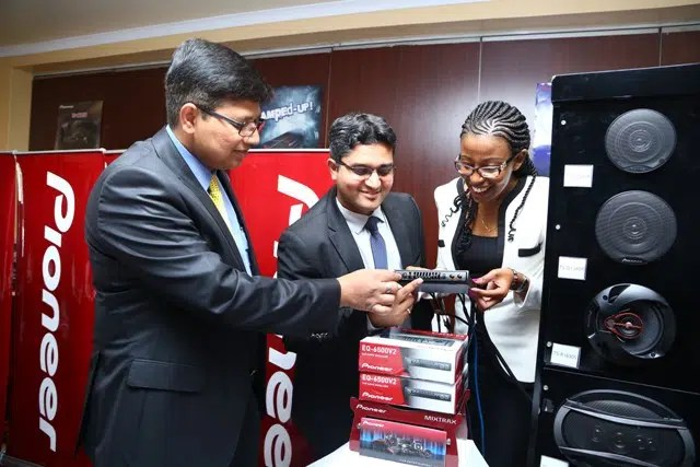 From left Muralidhar Masala (General manager Pioneer) Prasanna Kumar (Assistant Manager) and Rachael Wambua (Assistant Manager) display some of the in-car entertainment products launched in Kenya yesterday