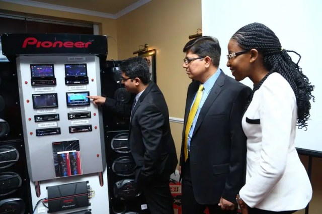 From left Prasanna Kumar Pioneer Gulf FZE Assistant Manager, Muralidhar M(General Manager) and Rachael Wambua Assistant Manager look at the in-car entertainment systems.