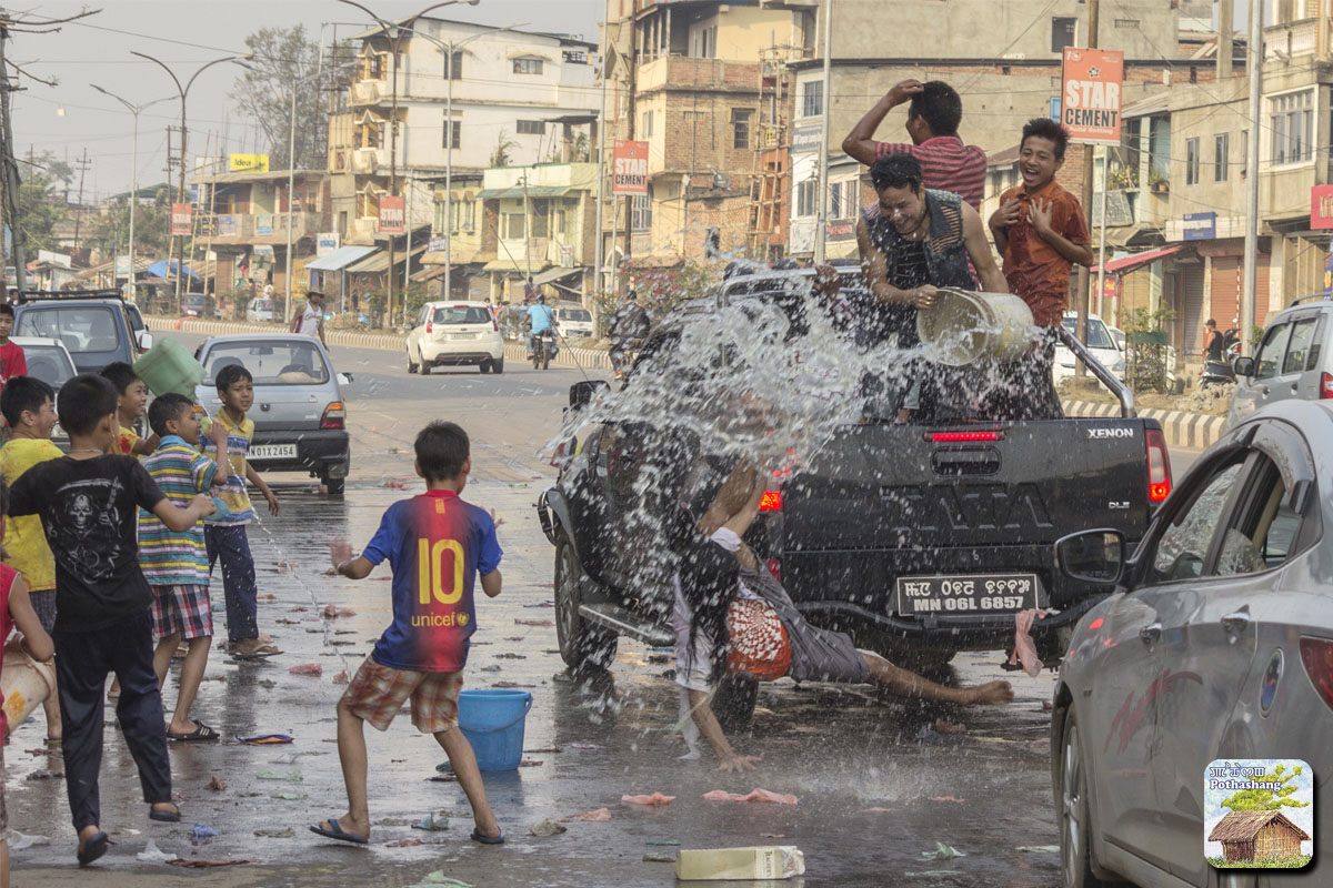 Kids and adults playing water during Yaoshang (Holi) festival in Manipur
