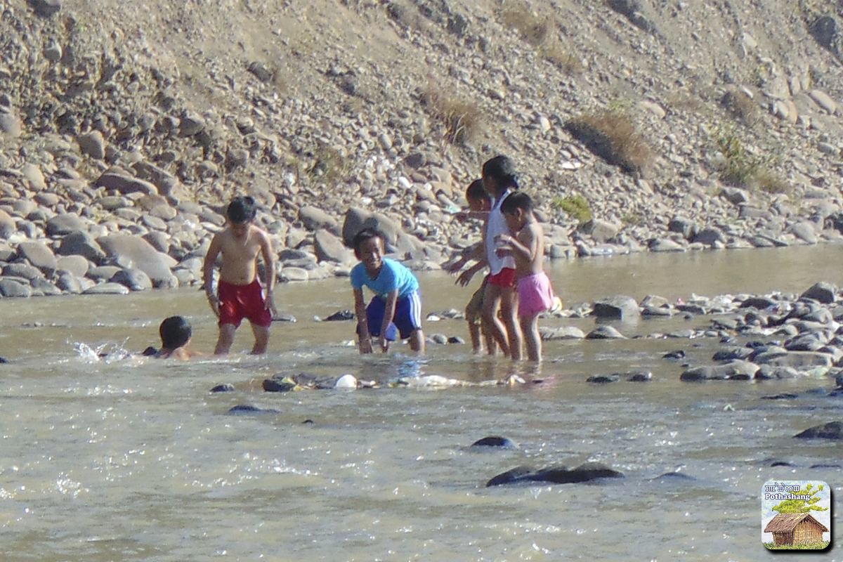Kids playing on a riverbank in Sekmai, Manipur