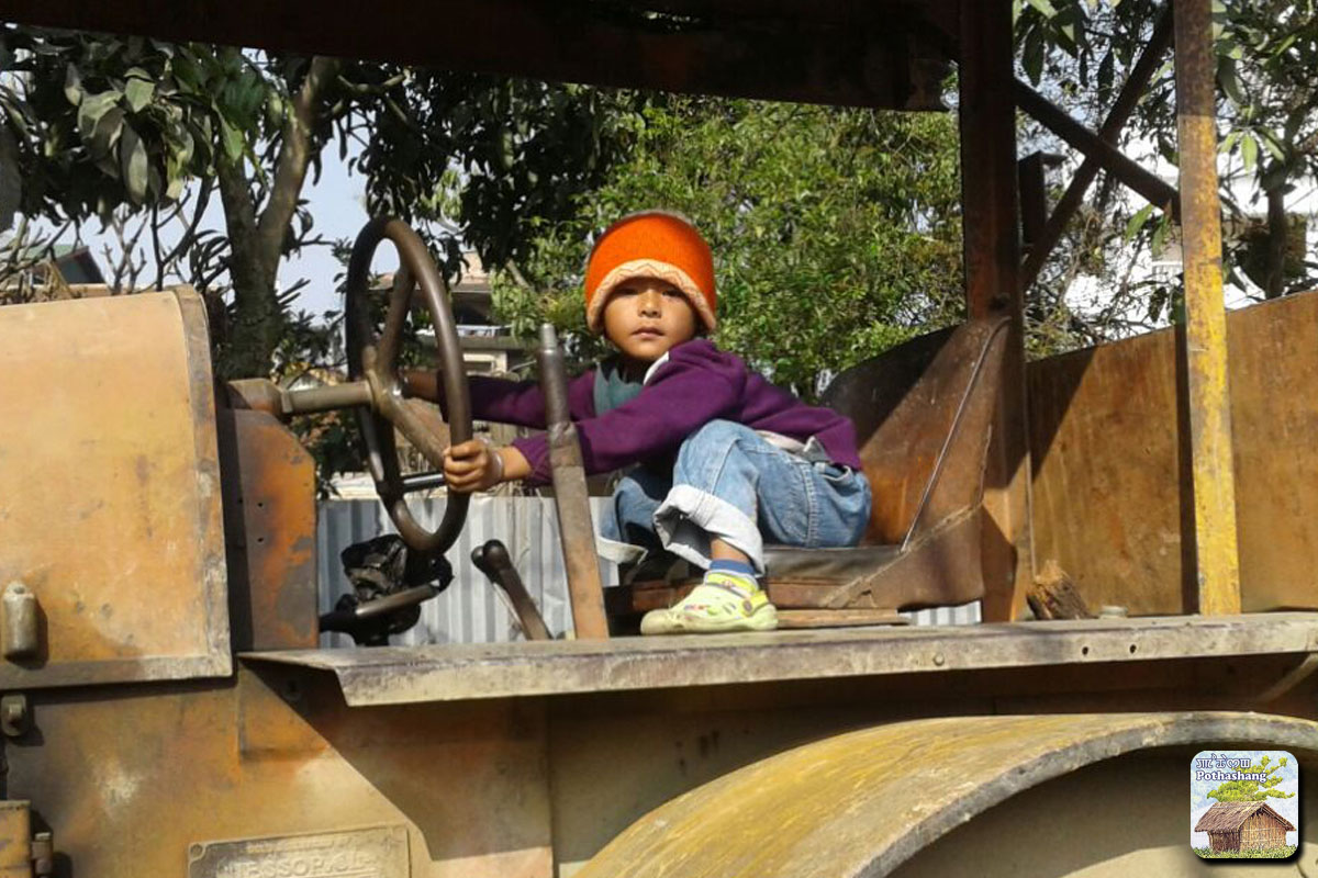 A child playing on a road roller