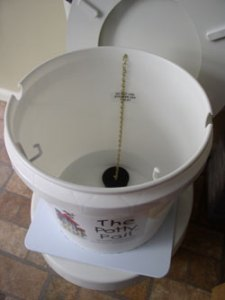 toilet bucket pre-wash system for cloth diapers setting on toilet with drainstopper