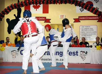 Sparring with my training partner Rob Skrepnek. I am on the far right.