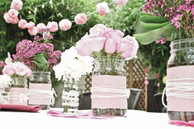 wedding-flower-centerpieces-pink-roses-wax-flowers- +5 Tips to Decorate Your Outdoor Wedding