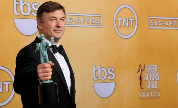 Alec-Baldwin-poses-backstage-with-the-award-for-outstanding-male-actor-in-a-comedy-series-for-30-Rock-at-the-19th-Annual-Screen-Actors-Guild-Awards The 10 Most Famous Male Actors with Awards