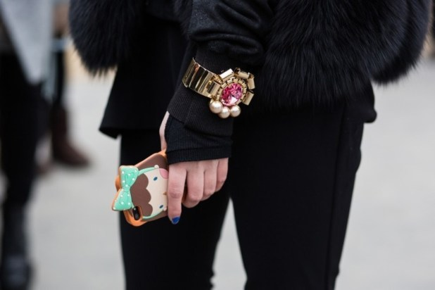 wearing-bracelets-over-gloves-and-sleeves-2 23 Most Breathtaking Jewelry Trends in 2017