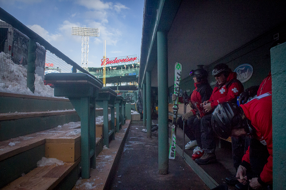 Patrollers take a break from the wind in the visitor's dugout as Pesky's Pole looks on. For each heat, four patrollers stationed out at the bottom landing area, two at the knuckle, and two at the top. The two in the sky brought up emergency sleds on the scaffolding lift, and then walked them the remaining three flights of stairs—170 feet off the ground. PHOTO: Kade Krichko