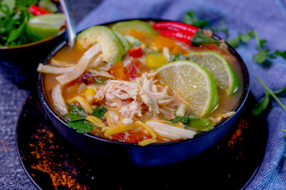 This Instant Pot Chicken Tortilla Soup is a perfect comfort food meal that comes together in minutes using your electric pressure cooker with amazing authentic flavours!