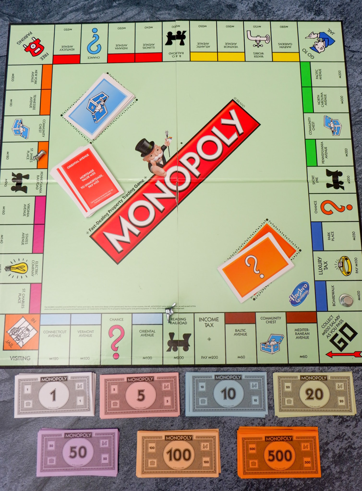 monopoly board and money
