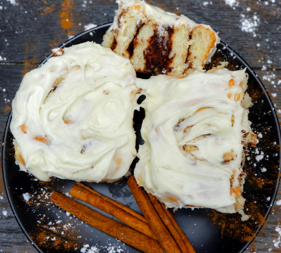 "Make this Cream Cheese Cinnamon Roll Recipe for a surprise treat your family will love! Cinnamon sugar in soft rolls topped with homemade cream cheese icing! To save time so you can eat this scrumptious treat even quicker we've cut out some of the waiting time and went the quick rise bread route, so you only have one ""rise"" to wait on."