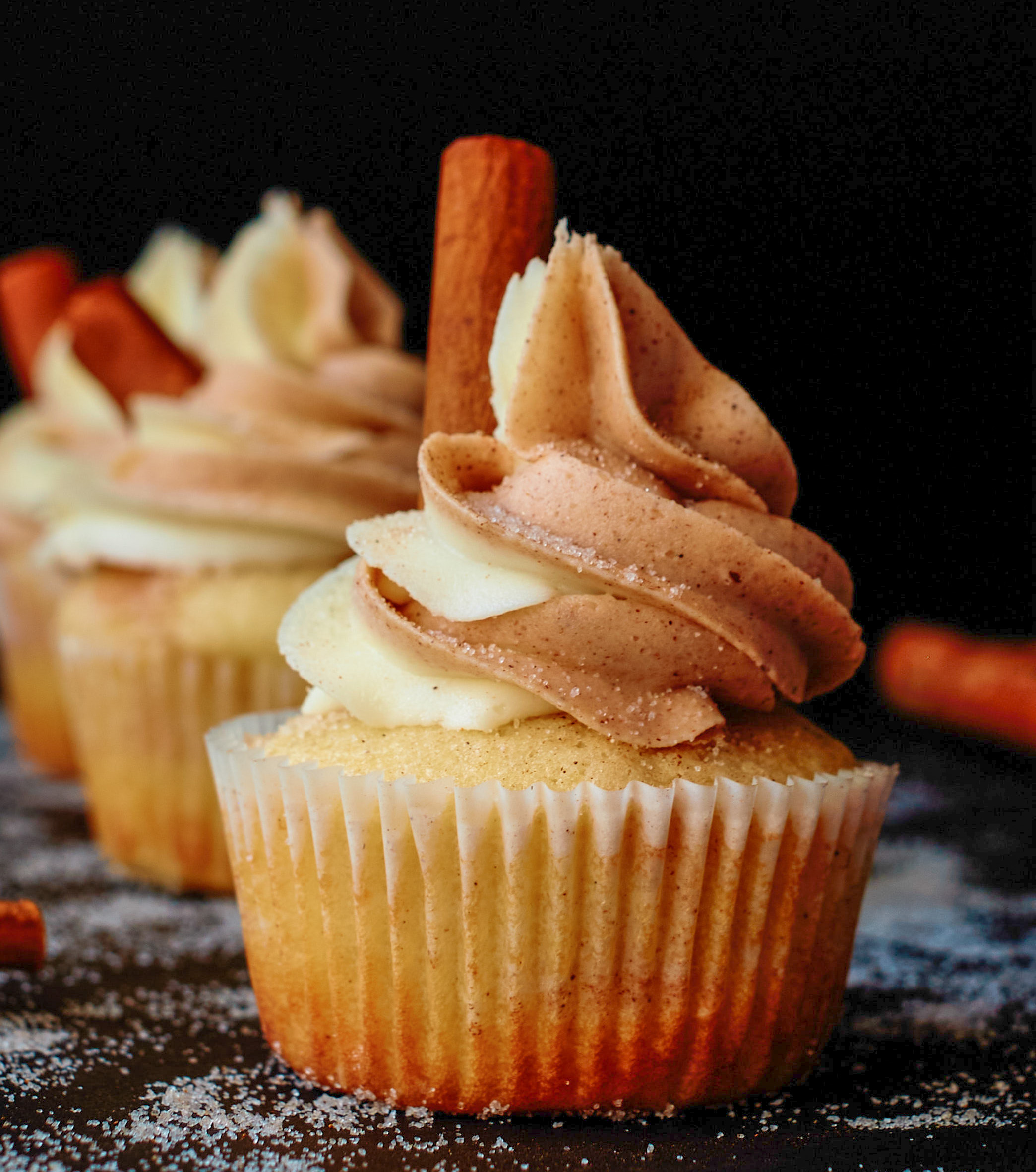 frosted cupcake with cinnamon stick