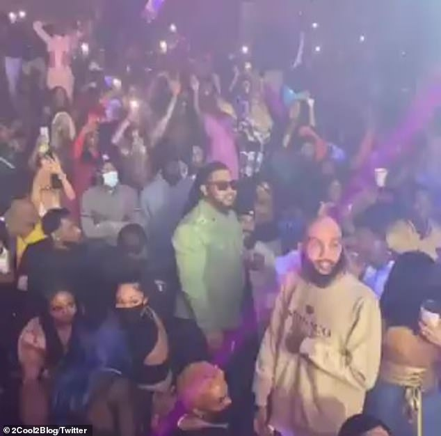 Crowd control: The shocking images show hundreds of people - many without masks - turning up in the jam packed nightclub to see him perform hits from 2005