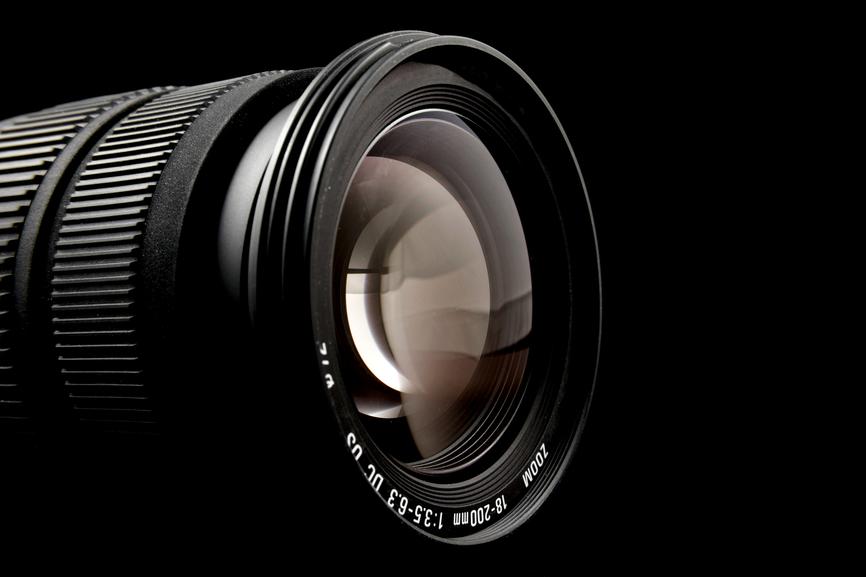 Closeup of camera lens over black background