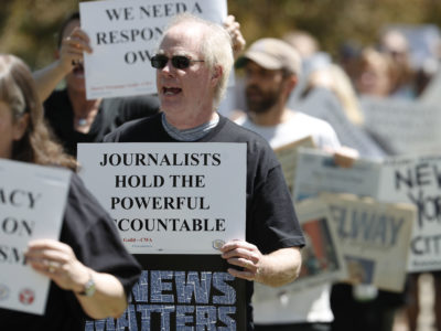 Gene Forbes, who works in the pre-press department of The Denver Post, walks with fellow employees during a rally against the paper's ownership group, Alden Global Capital, Tuesday, May 8, 2018, outside the paper's office and printing plant in north Denver. Members from all guild units were on hand in Denver for the rally at which they urged Alden Capital to invest in the newspapers that it controls or sell the properties. (AP Photo/David Zalubowski)