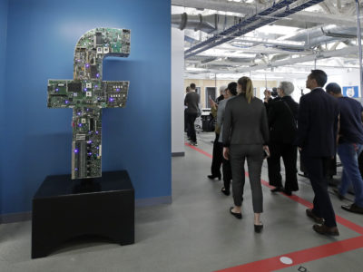 Media and guests tour Facebook's new 130,000-square-foot offices, which occupy the top three floors of a 10-story Cambridge, Massachusetts, building, on Jan. 9, 2019. Facebook has announced a major gift to local news. (AP Photo/Elise Amendola)