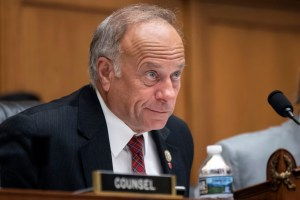 """U.S. Rep. Steve King (R-Iowa) listens during a hearing on Capitol Hill in 2018. On Tuesday, the House voted 416-1 for a resolution repudiating King's words expressing puzzlement about why terms like """"white nationalist"""" are offensive. (AP Photo/J. Scott Applewhite)"""