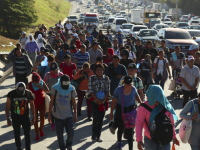 Migrants traveling in a group begin their journey toward the U.S. border as they walk along a highway in San Salvador, El Salvador, early Wednesday, Jan. 16, 2019. (AP Photo/Salvador Melendez)