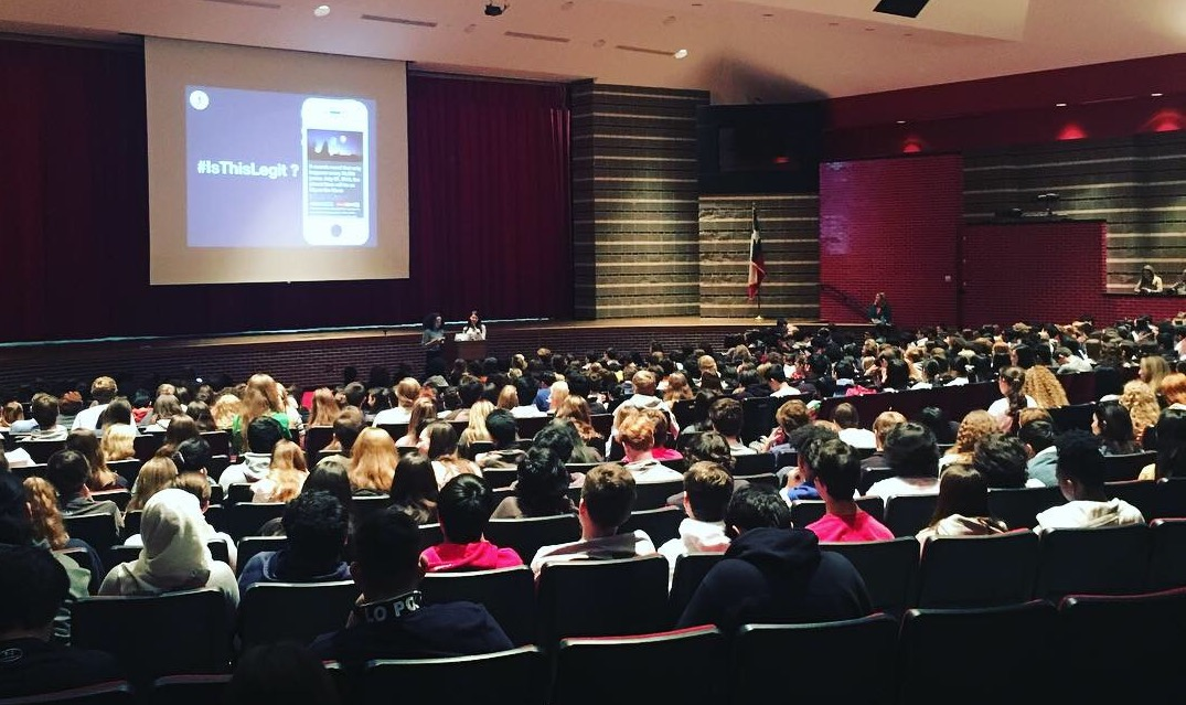 Hiwot Hailu (left) and Allison Graves lead a MediaWise fact-checking presentation at Memorial High School in Houston, Texas. (Photo by Katy Byron)