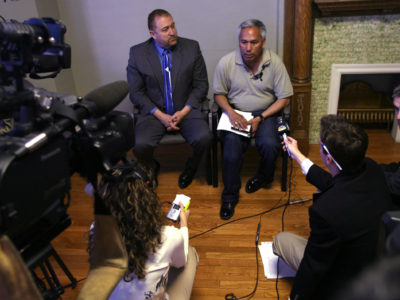 Mexican journalist Emilio Gutiérrez Soto, top right, and attorney Carlos Spector, left, meet with journalists following his release from detention in this file photo taken in 2009 in El Paso, Texas. Gutiérrez was released from an Immigrations and Customs Enforcement detention center after seven months imprisonment. Gutierrez and his then-15-year-old son fled to the U.S. border at El Paso to attempt to be granted asylum. (AP Photo/The El Paso Times, Victor Calzada)
