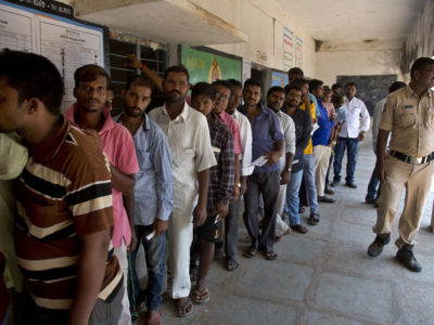 Indians wait in a queue to cast their votes during the first phase of general elections in Hyderabad, India, Thursday, April 11, 2019. (AP Photo/Mahesh Kumar A.)