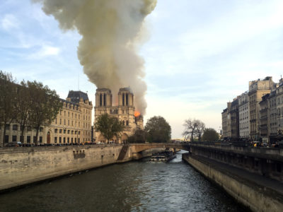 Notre Dame cathedral is burning in Paris, Monday, April 15, 2019. (AP Photo/Lori Hinnant)