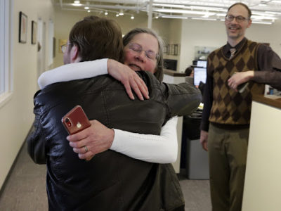 Pittsburgh Post-Gazette City Editor Lillian Thomas hugs reporter Andrew Goldstein in the paper's downtown Pittsburgh newsroom. (AP Photo/Gene J. Puskar)