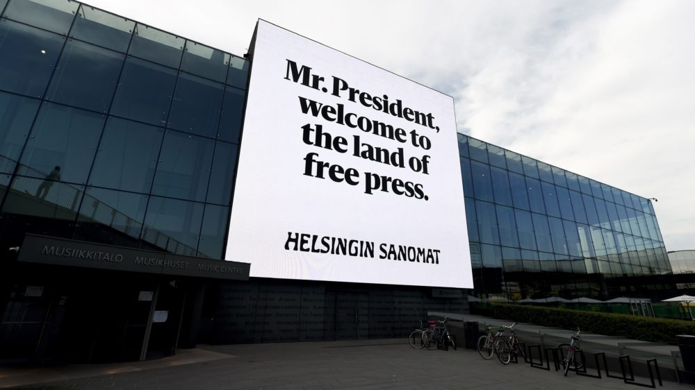 "In this July 14, 2018 photo an advert by Finnish newspaper Helsingin Sanomat stating ""Mr. President, welcome to the land of free press"" is seen on the wall of Helsinki Music Centre in Helsinki. US President Donald Trump is meeting Russian President Vladimir Putin on Monday, July 16, 2018 in the Finnish capital. (Aleksi Tuomola/Lehtikuva via AP)"