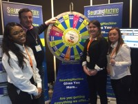 David from Ashley Sports (second left) spins to win at PPExpo 2017 with (l-r) Sohpia Atkinson, Sara Farrell and Emma Duncan.