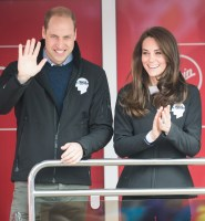 The Duke and Duchess of Cambridge cheer on the runners at the London marathon. (Photo by Samir Hussein/WireImage)