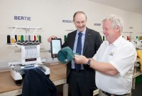 Alan Jones (R) shows the new embroidery machine Bertie to Trefor Rowlands