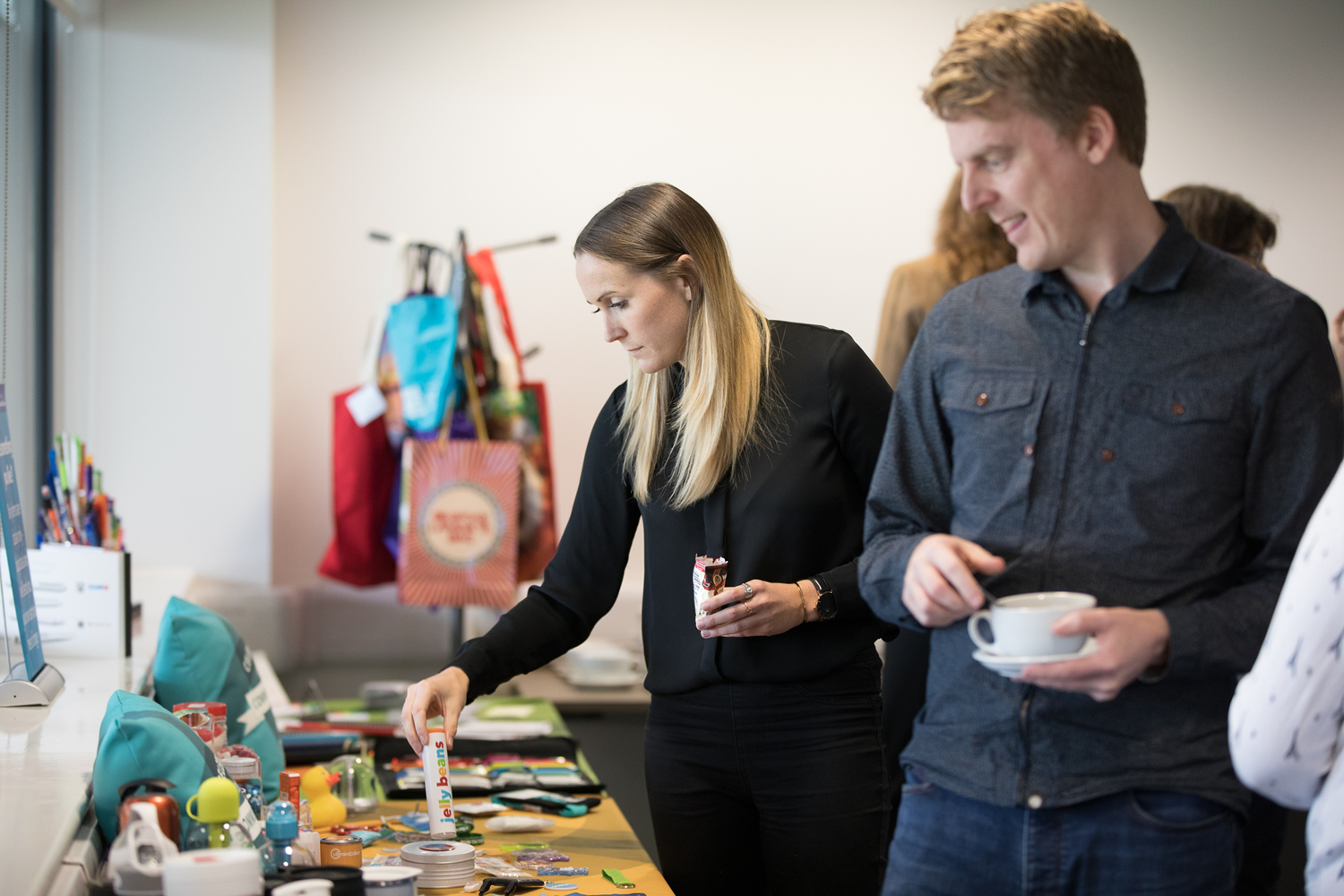 Conference delegates browse promotional merchandise