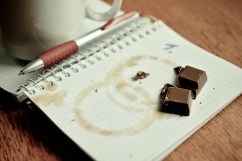 stained notebook with chocolate illustrating an article for writers on New Year