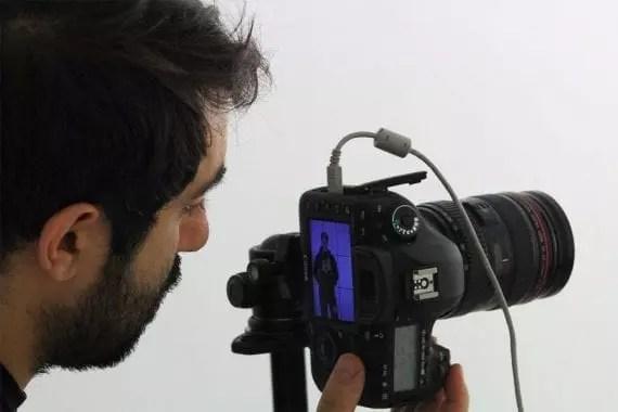 A man shoots a video with a DSLR camera. <em>Photo: Stefano Intintoli.</em>