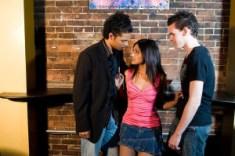 girl flirting with two guys
