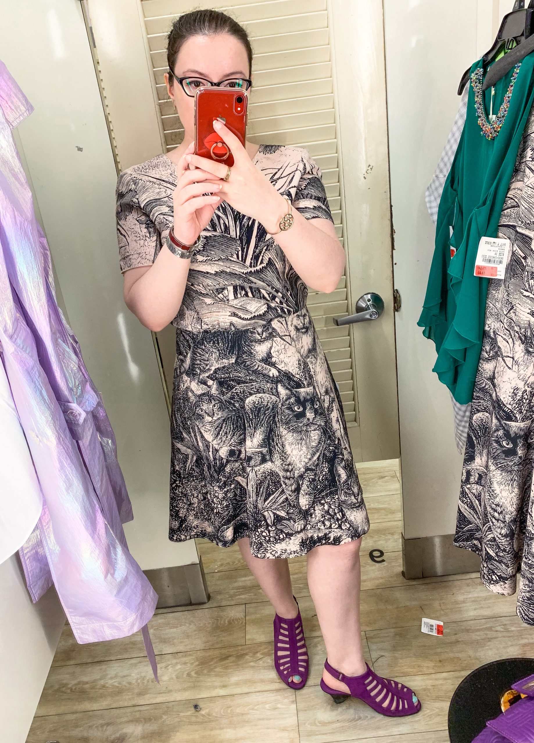 NYC Fashion blogger trying on a dress inside Century 21 department store dressing room