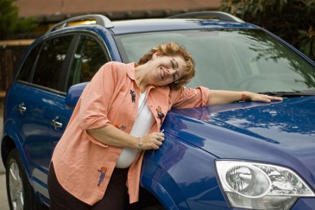 Woman hugging her new car