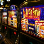 This picture shows a bank of slot machines in a Las Vegas casino.