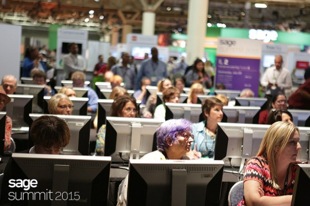 This picture shows people sitting in front of computers in a classroom session at Sage Summit 2015.