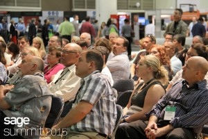This picture shows many customers seated in an open session at Sage Summit