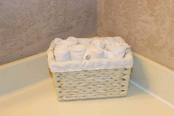 Washclothes rolled up in a basket