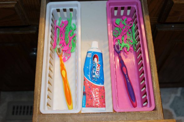separate baskets for toothbrushes and flossers