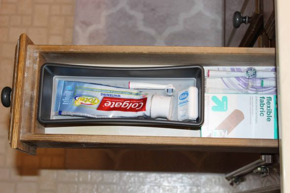 drawer organizer to keep toothbrush, toothpaste, and floss