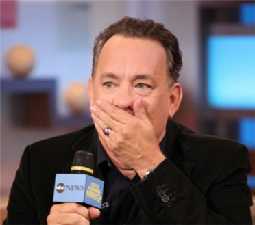 148-tom_hanks_covering_mouth