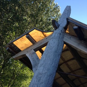 The soaring framework for the workshop porch roof looks a bit like a breaching humpback whale.