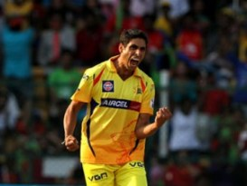 Ashish Nehra of The Chennai Superkings celebrates the wicket of AB de Villiers of the Royal Challengers Bangalore during match 53 of the Pepsi Indian Premier League Season 2014 between the Royal Challengers Bangalore and the Chennai Superkings held at the M. Chinnaswamy Stadium, Bangalore, India on the 24th May  2014 Photo by Deepak Malik / IPL / SPORTZPICS Image use subject to terms and conditions which can be found here:  http://sportzpics.photoshelter.com/gallery/Pepsi-IPL-Image-terms-and-conditions/G00004VW1IVJ.gB0/C0000TScjhBM6ikg