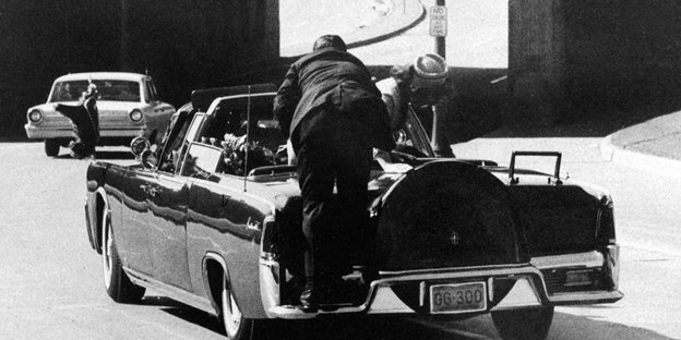 "ADVANCE FOR USE SUNDAY, NOV. 17, 2013 AND THEREAFTER - FILE - In this Friday, Nov. 22, 1963 file photo, President John F. Kennedy slumps down in the back seat of the Presidential limousine as it speeds along Elm Street toward the Stemmons Freeway overpass in Dallas after being fatally shot. First lady Jacqueline Kennedy leans over the president as Secret Service agent Clint Hill pushes her back to her seat. ""She's going to go flying off the back of the car,"" Hill thought as he tried to secure the first lady. (AP Photo/James W. ""Ike"" Altgens)"