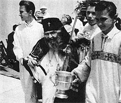 St. John sprinkling with holy water at his last Pascha in 1966. Pavel Lukianov is behind his left shoulder.