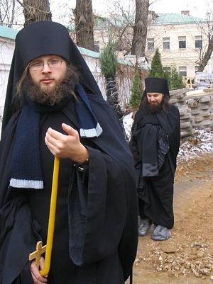 После пострига. На заднем плане монах Николай