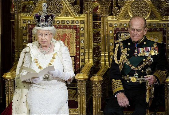 Queen Elizabeth II addressing both Houses of Parliament, with her consort Prince Philip looking on.