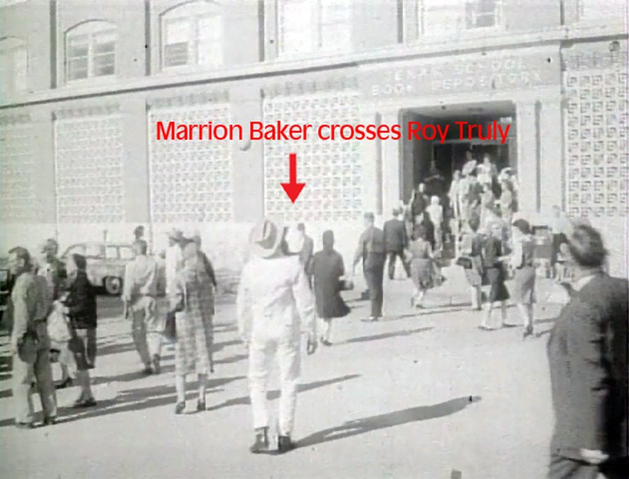 Marrion Baker crosses Roy Truly on his way towards the front steps of the TSBD